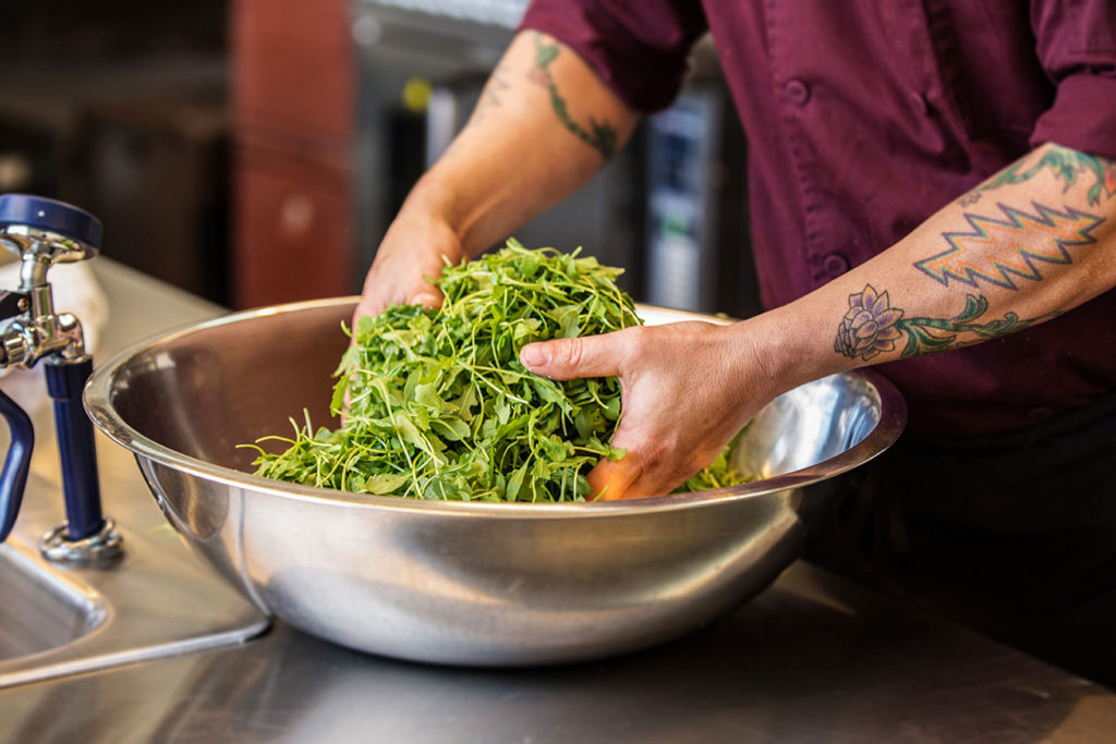 chef mixing salad, photo by Wildly Simple Productions