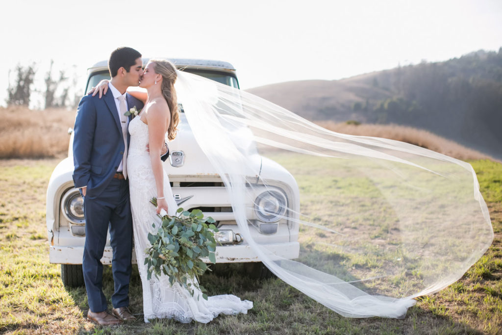 bride and groom kiss in the wind, wedding catering by park avenue catering, photo by Sabine Scherer Photography