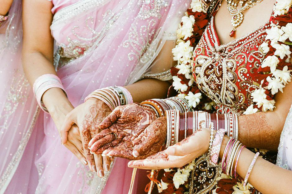 Traditional Indian Wedding, henna tattooed hands.